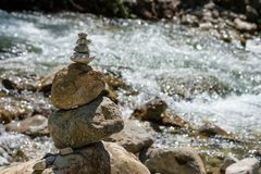 Cairns at a mountain stream as symbol for balance Stock Photography