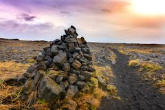 Cairns piles of volcanic stones Royalty Free Stock Photos