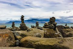 Cairns in Reykjavik. These seaside cairns rock piles in Reykjavik make a whimsical foreground to the Arctic Ocean stock image