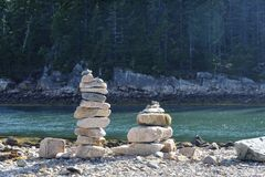Cairns on rocky inlet Royalty Free Stock Image