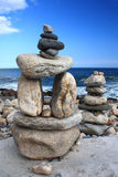 Cairns. On rocky shoreline in narragansett, ri royalty free stock images