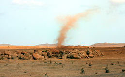 Cairns and Tornado. In the desert in the island of Boa Vista in Cape Verde stock images