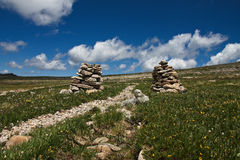 Cairns on a trail. Two cairns are showing the good path in Rocky Mountains National Park Royalty Free Stock Images