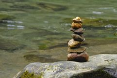 A cairn marks the presence of a visitor of the La Fortuna River. royalty free stock photo