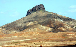 Cairns and Volcano. In the desert in the island of Boa Vista in Cape Verde royalty free stock photography