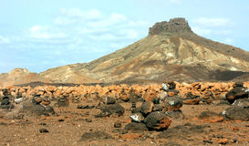Cairns and Volcano. In the desert in the island of Boa Vista in Cape Verde stock photography