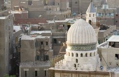 Cairo Cityscape - Old Mosque Renewal. View of cairo with some old rural buildings in the background and a mosque under renewal with some construction work Stock Image