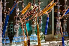 Cairo, Egypt April 30 2011:Shisha Water Pipes Lined up on the shelf at a cafe in Cairo. Shisha Water Pipes Lined up on the shelf at a cafe in Cairo, waiting for Royalty Free Stock Photo