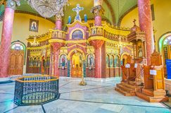 The interior of Saint George Orthodox Church in Cairo, Egypt. CAIRO, EGYPT - DECEMBER 23, 2017: The beautiful interior of St George Church with stone iconostasis Stock Images