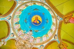 The painted cupola of Saint George Church in Cairo, Egypt. CAIRO, EGYPT - DECEMBER 23, 2017: The beautiful painted arcade with mural of Christ on the cupola of Royalty Free Stock Photography