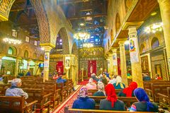 The interior of the Hanging Church in Cairo, Egypt. CAIRO, EGYPT - DECEMBER 23, 2017: The central Nave of the Hanging Church with medieval decorated iconostasis Royalty Free Stock Photos