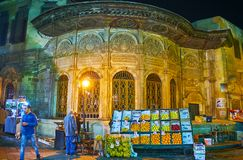 CAIRO, EGYPT - DECEMBER 21, 2017: The evening shopping in Al Muizz street of old Bazaar, with a view on medieval sabil-kuttab of royalty free stock photos