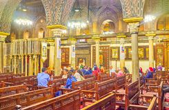Visiting the Hanging Church in Coptic Cairo, Egypt. CAIRO, EGYPT - DECEMBER 23, 2017: The interior of the Hanging Church is a fine example of Coptic medieval Royalty Free Stock Photography