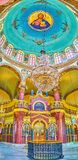 Panorama of Saint George Church in Coptic Cairo, Egypt. CAIRO, EGYPT - DECEMBER 23, 2017: Panoramic view on stone iconostasis and painted cupola of Saint George Royalty Free Stock Images