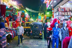 CAIRO, EGYPT - DECEMBER 21, 2017: The small tuk tuks are perfect transport to drive along the busy Al Muizz street, occupied with royalty free stock photo