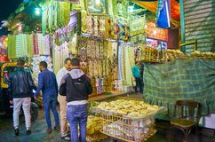 CAIRO, EGYPT - DECEMBER 21, 2017: The street seller with flatbread baskets in old bazaar of Al Muizz street, on December 21 in royalty free stock photo
