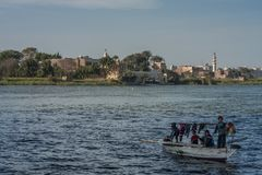 Cairo, Egypt February 11 2012: Egyptian family in a Small Boat on the River Nile in the middle of Cairo stock photos