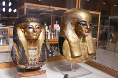 Ancient goldy Masks - Egyptian museum stock image