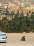 CAIRO, EGYPT - NOVEMBER 9, 2008: Bus and a motorcycle near the c Stock Images