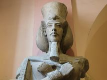 CAIRO, EGYPT- SEPTEMBER, 26, 2015: colossus of akhenaten in cairo, egypt. CAIRO, EGYPT- SEPTEMBER, 26, 2015: colossus of akhenaten with crook and flail in cairo stock photography
