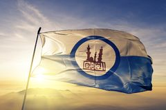 Cairo Governorate of Egypt flag textile cloth fabric waving on the top sunrise mist fog. Beautiful royalty free stock image