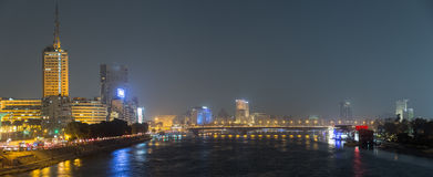 Cairo night panormic. Panoramic night view of Cairo center, the Nile river and the island of Zamalek, in the distance the 6th October bridge and the city royalty free stock photos
