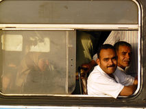 Cairo people. Men in Cairo look through the window of public bus stock photography