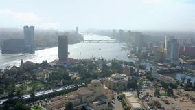 Cairo from the top, Egypt. Enjoy aerial cityscape of two cities from the top of Cairo Tower, overlooking Cairo, Giza, Gezira Island and curved Nile river, Egypt stock video