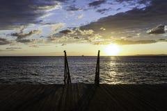 Cais de madeira em um por do sol Imagem de Stock Royalty Free