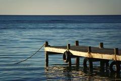 Cais do mar no por do sol fotografia de stock royalty free