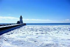 Cais e farol de Dôvar do porto Fotografia de Stock Royalty Free