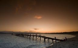 Cais no nascer do sol Imagens de Stock