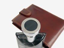 Caisse de cuir de bouteille de parfum Photographie stock