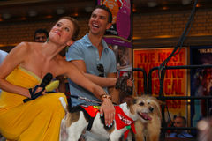 Caissie Levy & Richard Fleeshman. Of ghost pose with adoptable pups Stock Photo