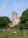 Caister Castle. Ruins of a roman castle in Caister on the Norfolk Coast of England.  With flag flying Stock Images
