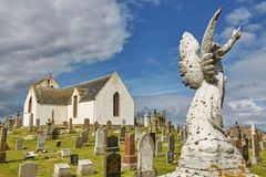 Graveyard at Canisbay church, the most northerly parish church on the Scottish mainland, near John O`Groats. CAITHNESS, SCOTLAND, UK - AUGUST 08, 2017: Graveyard royalty free stock photo