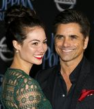 Caitlin Mchugh and John Stamos. At the World premiere of Disney`s `Mary Poppins Returns` held at the Dolby Theatre in Hollywood, USA on November 29, 2018 royalty free stock photography