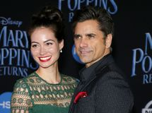 Caitlin Mchugh and John Stamos. At the World premiere of Disney`s `Mary Poppins Returns` held at the Dolby Theatre in Hollywood, USA on November 29, 2018 stock photo