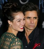 Caitlin Mchugh and John Stamos. At the World premiere of Disney`s `Mary Poppins Returns` held at the Dolby Theatre in Hollywood, USA on November 29, 2018 royalty free stock image