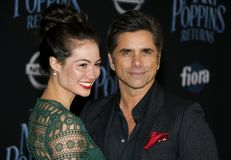 Caitlin Mchugh and John Stamos. At the World premiere of Disney`s `Mary Poppins Returns` held at the Dolby Theatre in Hollywood, USA on November 29, 2018 stock photos