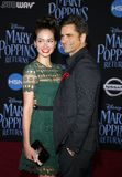 Caitlin Mchugh and John Stamos. At the World premiere of Disney`s `Mary Poppins Returns` held at the Dolby Theatre in Hollywood, USA on November 29, 2018 stock image