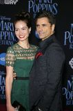 Caitlin Mchugh and John Stamos. At the World premiere of Disney`s `Mary Poppins Returns` held at the Dolby Theatre in Hollywood, USA on November 29, 2018 royalty free stock images