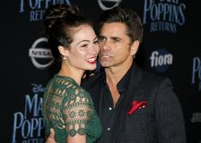 Caitlin Mchugh and John Stamos. At the World premiere of Disney`s `Mary Poppins Returns` held at the Dolby Theatre in Hollywood, USA on November 29, 2018 stock images
