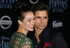 Caitlin Mchugh and John Stamos. At the World premiere of Disney`s `Mary Poppins Returns` held at the Dolby Theatre in Hollywood, USA on November 29, 2018 stock photography
