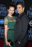 Caitlin Mchugh and John Stamos. At the World premiere of Disney`s `Mary Poppins Returns` held at the Dolby Theatre in Hollywood, USA on November 29, 2018 royalty free stock photos
