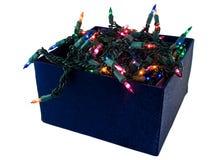 Caixa azul de veludo de luzes de Natal Fotografia de Stock Royalty Free