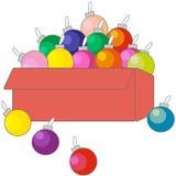 Caixa com as bolas dos brinquedos das decorações do Natal ilustração do vetor