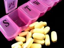 Caixa cor-de-rosa do comprimido Imagens de Stock