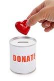 Caixa da doação e coração vermelho Imagem de Stock