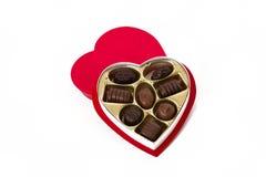 Caixa dada forma coração com doces de chocolate Fotos de Stock Royalty Free